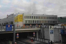 In this image provided by Daniela Schwarzer, smoke is seen at the Brussels airport after explosions were heard Tuesday. More than 30 people are dead and more than 200 wounded after two blasts hit the airport and another struck a metro station in the Belgian capital.