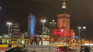 The Palace of Culture, right, the tallest building in the Polish capital, is lit in the colors of the Belgian flag in solidarity with the victims of the attacks in Brussels, in Warsaw, Poland, on Tuesday March 22, 2016.